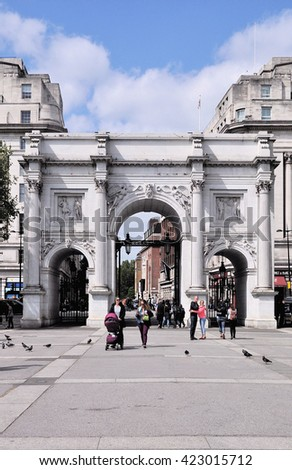 LONDON - MAY 14, 2016. Marble Arch was designed by John Nash in 1927, originally sited at Buckingham Palace but relocated in 1960 on a traffic island at the north end of Park Lane, London, UK. - stock photo