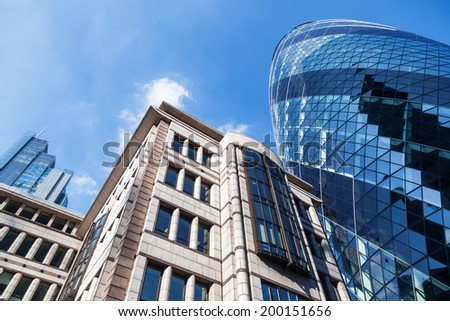 LONDON - MAY 18: modern buildings in the City of London on May 18, 2014 in London. The City is a major business and financial centre. London came top in the Worldwide Centres of Commerce Index in 2008 - stock photo
