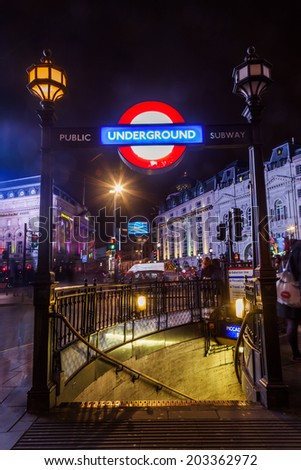 LONDON - MAY 23: night at Piccadilly Circus on May 23, 2014 in London. Its the junction of some of the busiest streets in London. During British Empire he was referred as the center of the world - stock photo