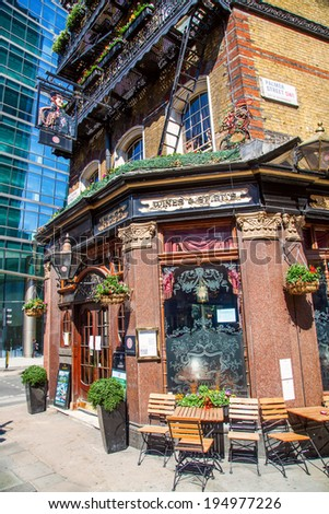 LONDON - MAY 18: Pub -The Albert- on May 18, 2014 in London. It was built 1862, named after the husband of Queen Victoria and survived the Blitz and a big redevelopment, is surrounded by skyscrapers. - stock photo