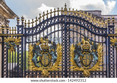 LONDON - MAY 31: Royal Crest at Buckingham Palace Gate - famous landmark, on May 31, 2013 in London. Built in 1705, Palace is official London residence and principal workplace of British monarch. - stock photo