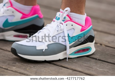 LONDON - MAY 27: Runner feet on road close up on shoe NIKE - men fitness jog workout wellness concept at the park in London on May 27. 2016 in UK - stock photo