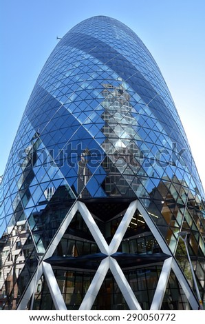 LONDON - MAY 13 2015: 30 St Mary Axe tower building. The building has become an iconic symbol of London and is one of the city's most widely recognised examples of contemporary architecture. - stock photo