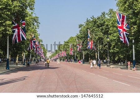 LONDON - MAY 31: The Mall is decorated with Union Jack flags to celebrate 60th Anniversary of Coronation of Britain's Queen Elizabeth II, on May 31, 2013 in London, England. - stock photo
