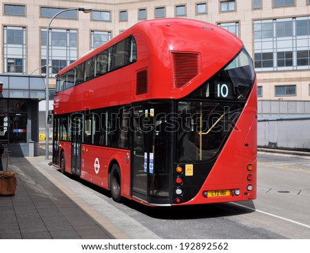 LONDON - MAY 10. The new Routemaster diesel-electric hybrid double deck bus unusually without applied advertising on May 10, 2014, at the Hammersmith bus station, west London, UK.  - stock photo