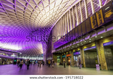 LONDON - MAY 19: ticket hall of the Kings Cross station with unidentified people on May 19, 2014 in London. It is one of the main stations of London, the modern renovation was designed by John McAslan - stock photo