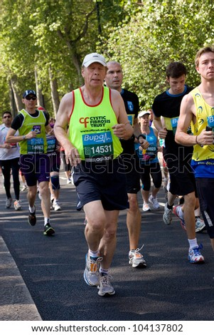 LONDON - MAY 27: Unidentified people run the London bupa 10K on May 27th 2012 in London, England, UK. The Bupa 10k is an annual event