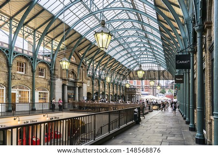 LONDON - MAY 31: View of Covent Garden market on May 31, 2013 in London. Covent Garden - one of the main tourist attractions in London - is known for its restaurants, pubs, market stalls and shops. - stock photo