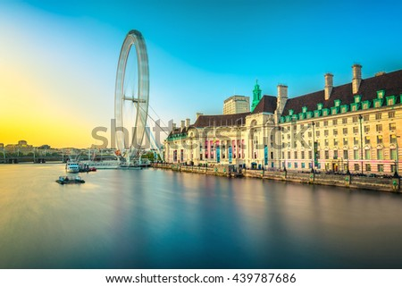 LONDON - MAY 14, 2016: View of the London Eye at sunset. London Eye (135 m tall, diameter of 120 m) - a famous tourist attraction over river Thames in the capital city London. - stock photo