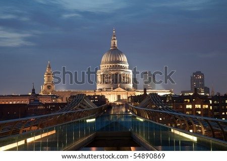 London Millennium bridge over river Thames. St Paul's Cathedral in the distance - stock photo
