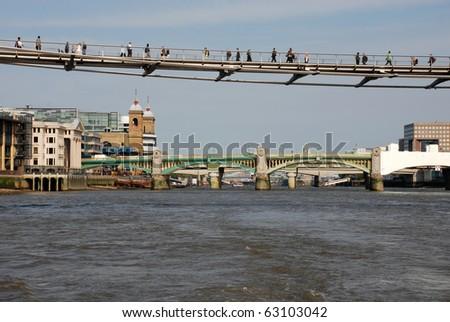 London Millennium Footbridge, Southwark Bridge - stock photo