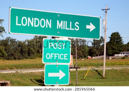 LONDON MILLS, IL-MAY, 2015:  Sign for a small midwestern farming town. Nearly unchanged in the past 100 years, London Mills is representative of many farming communities across the country.