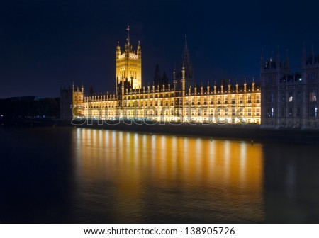 London night view. House of Parliament and reflections on river Thames, London dusk - stock photo