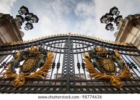 LONDON - NOV 5: Gate of Buckingham palace on November 5, 2011 in  London U.K. Buckingham palace is the official residence of Queen Elizabeth II and one of the major tourist destinations U.K. - stock photo