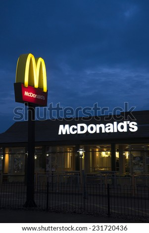 LONDON - NOV 16: McDonalds logo on blue sky background on Nov 16, 2014, London, UK. It is the world's largest fast food chain, over 31,000 restaurants worldwide, serve 58 million customers each day