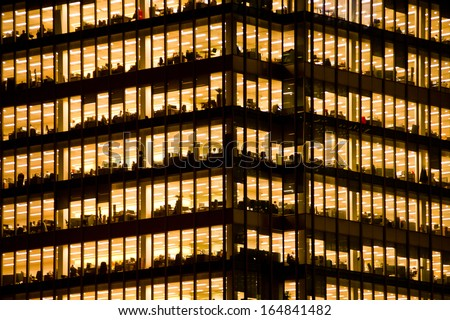 LONDON - NOV 28: people work in an office building in London on November 28, 2013. Full-time employees in the UK work longer hours than the EU average, according to the Office for National Statistics. - stock photo