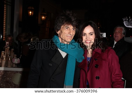 LONDON - NOV 25, 2015: Ronnie Wood and Sally Humphreys attends the Stella McCartney store Christmas lights switching on Nov 25, 2015 in London - stock photo
