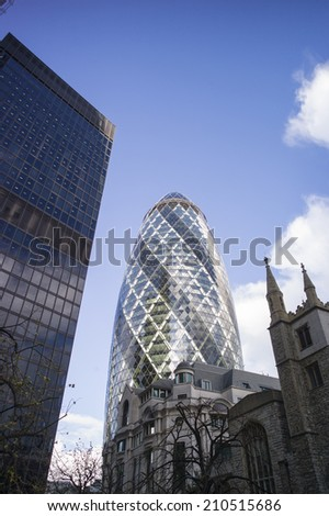 LONDON - NOV 6. The glass exterior of 30 St Mary Axe, known informally as the Gherkin on November 6 2014 in London, UK. The 180 meter building designed by Foster in the financial district.  - stock photo