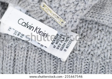 LONDON - NOVEMBER 16: Calvin Klein care label on a grey woolen garment. November 16, 2014 in London, UK. - stock photo