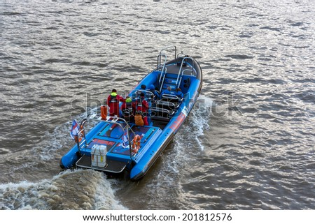 LONDON - NOVEMBER 3 : Jet boat on the River Thames in London on November 3, 2013. Unidentified people. - stock photo