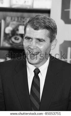 LONDON - NOVEMBER 25: Oliver North, former U.S. Marine Corps Lieutenant Colonel involved in the Iran-Contra affair (known as Irangate), attends a book signing event on November 25, 1991 in London. - stock photo