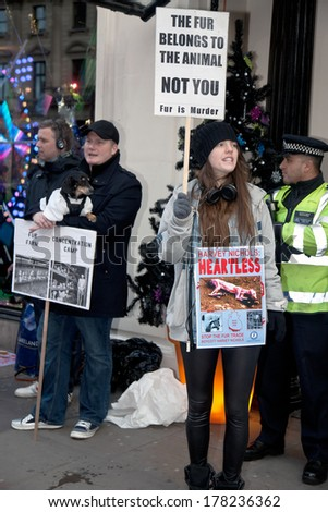 LONDON - NOVEMBER 30: Protestors stand outside Harvey Nichols Knightsbridge store protesting at the sale of animal fur products and demanding a boycott of the store on November 30, 2013 in London