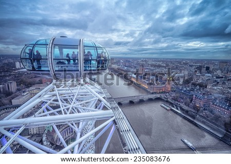 LONDON - November 17, 2014: View of London Eye, Europe's tallest Ferris wheel on the South Bank of the River Thames, a famous tourist attraction. November 17 - stock photo