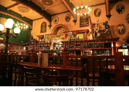 LONDON - OCT 28: Interior of pub, for drinking and socializing, focal point of the community, on Oct 28, 2010, London, UK. Pub business, now about 53,500 pubs in the UK, has been declining every year - stock photo