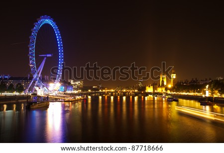 LONDON - OCT. 15: Night view of The London Eye on October 15, 2011 in London, England. The London Eye is the most popular attraction of the UK and the tallest Ferris Wheel in Europe - stock photo