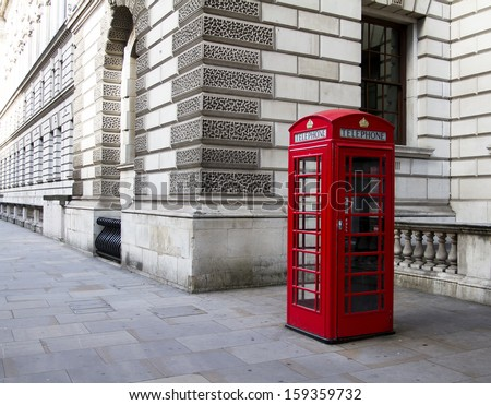 LONDON - Oct 10: Old telephone booth on Oct 10, 2013 in London. With more than 14 million international arrivals in 2009, London is the most visited city in the world  - stock photo