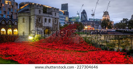 LONDON - Oct  24  2014: The art installation in Tower Bridge which features 888,246 ceramic poppies, one for every Allied soldier killed during the conflict, marks WW1 centenary