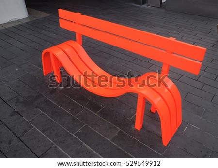 LONDON - OCTOBER 15, 2016. A bright orange formed timber seat on the forecourt of the Royal Festival Hall in central london, UK.