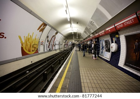 LONDON- OCTOBER 25: An interior view of the Underground Tube System in London, England on October 25, 2009. London's system is the oldest underground railway in the world, dating back to 1863. - stock photo