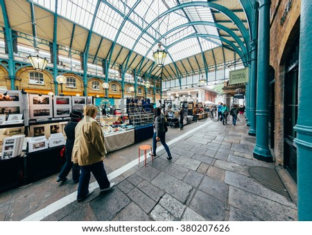 LONDON - OCTOBER 11  Apple market in Covent Garden. October 11, 2013 in London. One of the most popular tourist attraction on Earth. Toned Image. - stock photo