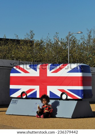 LONDON - OCTOBER 27. London celebrates the importance of its buses with 41 decorative bus models on October 27, 2014; this one painted with the Union Jack flag by Kristel Movahed in east London, UK. - stock photo