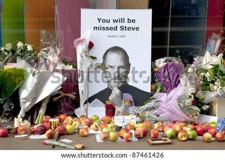 LONDON - OCTOBER 9: Shrine to Steve Jobs outside the Regent Street Apple Store on October 9, 2011 in London. Jobs, former CEO of Apple, died on October 5, 2011 after battling Pancreatic cancer. - stock photo