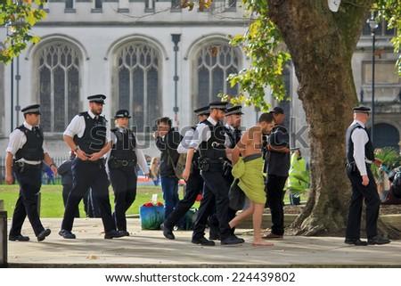 LONDON - OCTOBER 18, 2014: Thousands of people have protested in London about pay and austerity. Many have been arrested by police. Parliament street, London, UK, October 18, 2014.