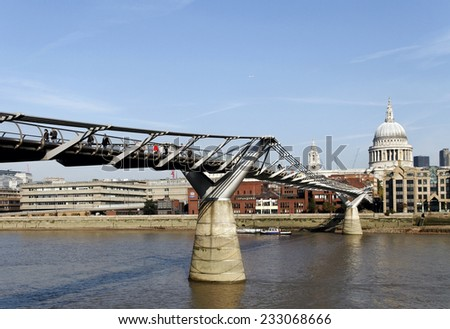 LONDON - 16 OKTOBER 2011: Random People Passing at Famous Millennium Bridge at River Thames in London. View to the St. Pauls Cathedral on 16 Oktober 2011, London. - stock photo