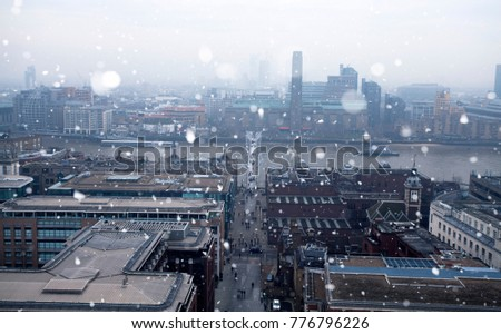 London on a cold winter day with falling snow.