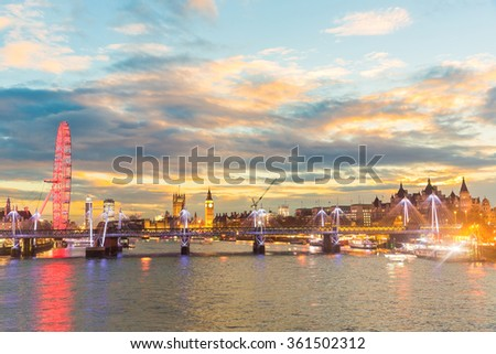 London panoramic view at sunset with illuminated skyline. Photo taken from Waterloo bridge, with some of the most famous landmarks in London, Big Ben is in the middle. Travel and architecture concepts - stock photo