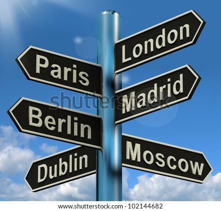 London Paris Madrid Berlin Signpost Shows Europe Travel Tourism And Destinations - stock photo