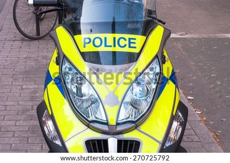 London Police motor bike parked on a pavement close up - stock photo