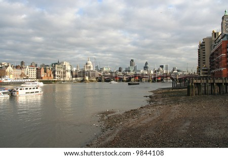 London, River Thames with St. Pauls and City highrise in the distance