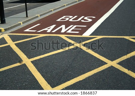 London. Road in  the city. Sectoring for buses and pedestrians. Red, white and yellow lines. - stock photo