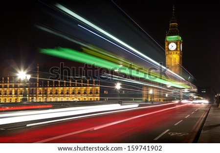 London's Big Ben with streaks of light from passing traffic