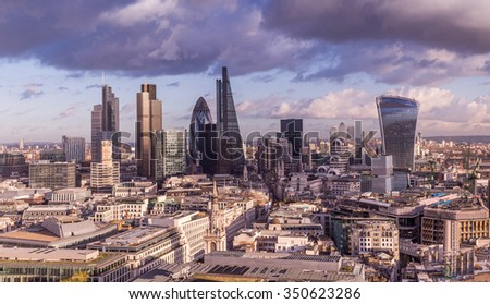 London's business district with dramatic clouds and skyscrapers - UK