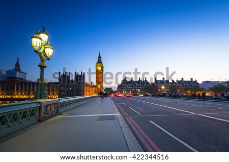 London scenery at Westminster bridge with Big Ben and blurred red bus, UK - stock photo