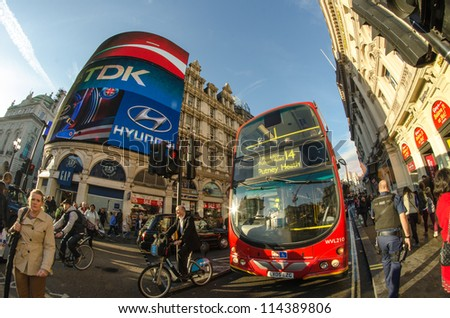 LONDON - SEP 28: Double decker bus speeds up in Piccadilly, September 28, 2012 in London. Made from 1958 to 1968 and still used in some routes,the traditional bus has become a famous feature of London - stock photo