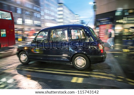 LONDON - SEP 27 : Taxi in the street of London on September 27, 2012 in London, UK. Cabs, Taxis, are the most iconic symbol of London as well as London's Red Double Decker Bus. - stock photo