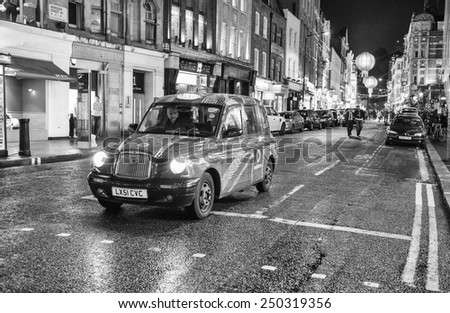 LONDON - SEP 29, 2013: Typical London Taxi Cab. All London cabs undergo a strict annual mechanical test before they are allowed to ply for hire